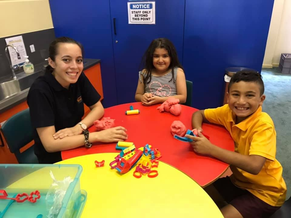 Children in kindy hall with carer